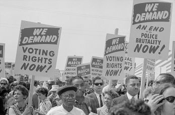 marchers_with_signs_at_the_march_on_washington,_1963