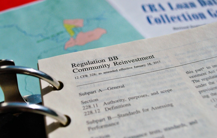 "A close-up of a piece of paper in a binder entitled ""Regulation BB Community Reinvestment"""